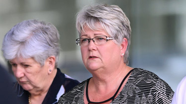 Witness Johanna Cornelia Dent (right) leaves the Supreme Court in Brisbane on Wednesday.