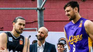 Melbourne United guard Chris Goulding (centre left) and Sydney Kings center Andrew Bogut (right) at the pre-season NBL jersey launch.