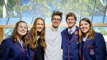 Sunbury Downs College students (L-R) Amber Karras , Jemma Denman, Adam Lacy and Kristina Zboril with past student Rory Healy (centre)  at the College campus in Sunbury.