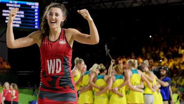 The Australians regroup after defeat as Beth Cobden celebrates.