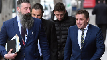 "Mark ""Bomber"" Thompson (right) arrives at court on Thursday."