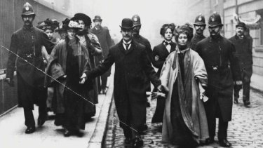 Emmeline Pankhurst (left) under arrest in May 1908.