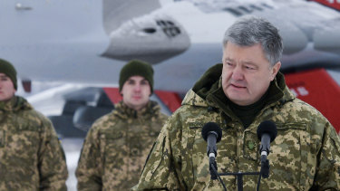 Ukrainian President Petro Poroshenko addresses the Armed Forces of Ukraine at the military airfield in the Vasylkiv region, Ukraine, earlier in December.