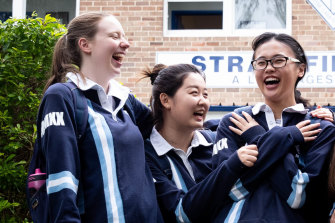 Annabel Knight, left, who has topped the state in information processes and technology, with her friends Gina Lee and Jenny Yang.
