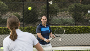 Federal Treasurer Josh Frydenberg with ex-professional tennis player Sally Peers at the Kooyong Tennis Club.