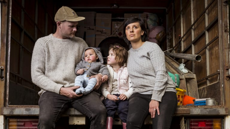 Dani Venn, husband Chris Burgess and their children, Oscar and Harlow, pack up their belongings.