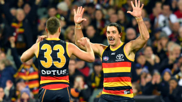 Taylor Walker celebrates a goal with Brodie Smith.
