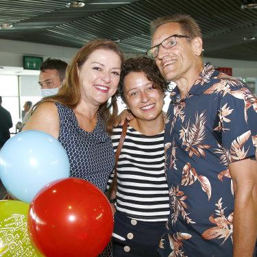 Graham and Natalie Auchterlonie welcome daughter Katherine at Brisbane Airport.