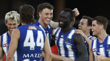 Majak Daw is mobbed by teammates.