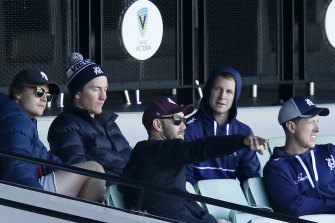 Will Pucovski (back left) and Glenn Maxwell (centre) support their Victorian teammates at the MCG on Sunday.