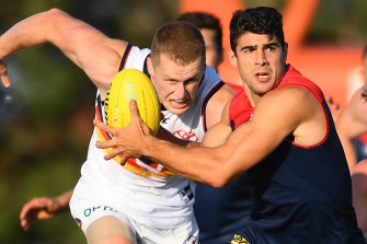 Christian Petracca dashes clear of the pack.