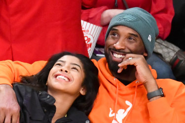 Kobe Bryant and daughter Gianna at a basketball game between the Los Angeles Lakers and the Dallas Mavericks at the Staples Center on December 29.