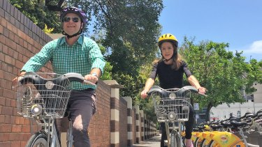 Adrian Schrinner and Anne Savage try out CityCycle.