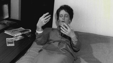 American ghosthunter Lorraine Warren shows how she lay back on a bed in the Gladesville home and explains that she felt vibrations.