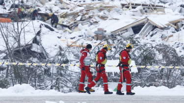 Rescue crews work in the area at Ask in Gjerdrum, Saturday January 2, 2021, after a massive landslide smashed into a residential area near the Norwegian capital on Wednesday.