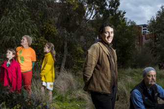 Members of the Upfield Urban Forest group: Anna Sinn, Greta and Esme Holroyd, Tamar Hopkins and Gerard Morel. They are photographed in the Urban Forest near Brunswick station.