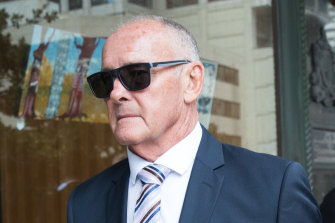 Chris Dawson, who is accused of murdering his wife over 30 years ago, leaves court on Thursday.