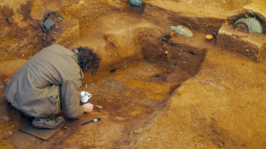 An archeologist works in an Anglo-Saxon Christian burial chamber at Prittlewell in Southend-on-Sea, England.