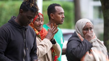 Shocked worshippers emerge from one of the mosques.