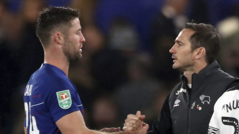 Chelsea defender Gary Cahill (left) and Lampard shake hands after the match.