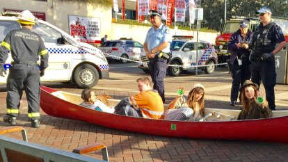 Climate change activists in canoe block Brisbane's Victoria Bridge