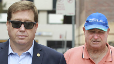 Former NSW police minister Troy Grant leaves Burwood Local Court with his father Kenneth Grant who appeared on charges relating to a hit-and-run road death.