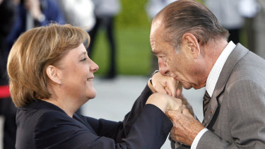 Former French president Jacques Chirac greets German Chancellor Angela Merkel in 2007.