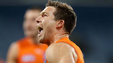Giants star Toby Greene celebrates a goal against the Cats.