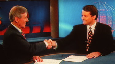 Tony Jones shaking Brian Naylor's hand during his final news bulletin on Channel Nine.