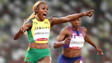 Elaine Thompson-Herah celebrates her gold.