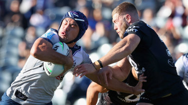 Jahrome Hughes tries to push off the Warriors at Central Coast Stadium.