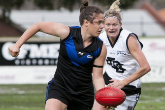 Emma Kearney playing for the Mugars – her two front teeth were knocked out during the first game she played with the team.