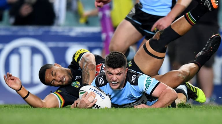 Night to remember: Chad Townsend dives over for Cronulla.