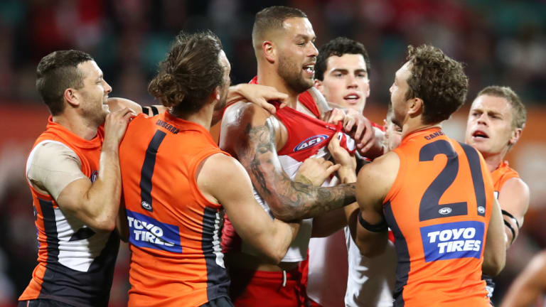 Lance Franklin of the Swans scraps with Matthew Buntine.