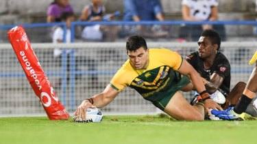 Stretch: Fifita reaches out for a try.