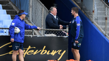 Costly shake? Bulldogs legend Terry Lamb greets Kieran Foran before training on Thursday.