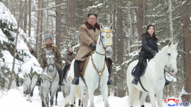 North Korean leader Kim Jong-un, centre, rides on a white horse during his visit to Mount Paektu.