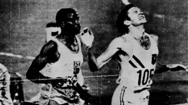 Elation: Ralph Doubell surges past  Wilson Kiprugut to win gold in Mexico City in 1968. It was a tactical masterpiece.
