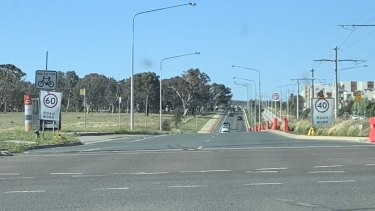 Three speed limit signs within metres of each other on Flemington Road in Canberra's north.