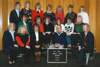 Father Searson with staff at Holy Family in 1992