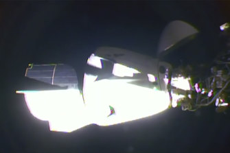 The SpaceX Dragon crew capsule, with NASA astronauts Doug Hurley and Robert Behnken aboard, docks with the International Space Station.