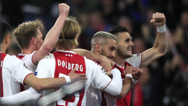 Better times: Ajax's Hakim Ziyech celebrates with Dusan Tadic (right) after scoring his side's second goal.