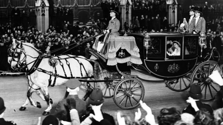 The married couple wave from a carriage on their way back to Buckingham Palace after the ceremony.