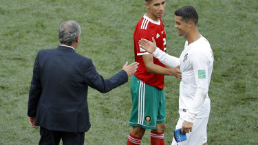 Star man: Santos and Cristiano Ronaldo shake hands after Portugal's win over Morocco.