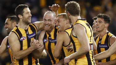 Rough and ready: Teammates gather to congratulate retiring Hawthorn champion Jarryd Roughead (fourth from left) after he added another goal to his tally against the Suns at Marvel Stadium on Sunday.