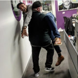 Who's carrying who? Bruno Bouchet gets a helping hand from his boss, Kyle Sandilands.