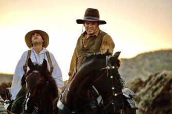 Joaquin Phoenix as Charlie, left, and John C Reilly as Eli in Jacques Audiard's adaptation of deWitt's 2011 novel The Sisters Brothers.