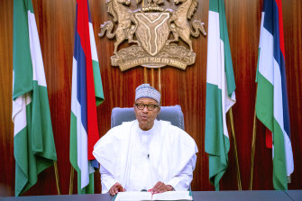 Nigeria's President Muhammadu Buhari, addresses the nation on a live broadcast, Thursday, Oct. 22, 2020.