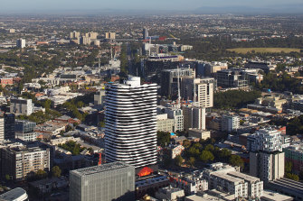 Barak's image towers over Swanston Street on the facade of a Melbourne apartment building.