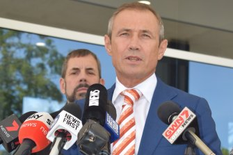 "WA Health Minister Roger Cook has apologised to patients ""quarantined"" in a hospital carpark."